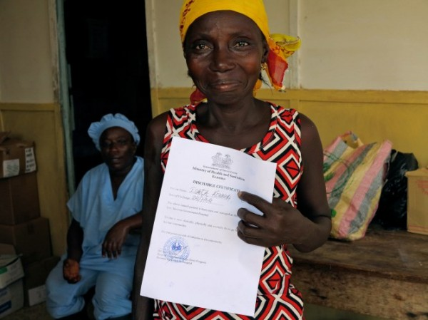 Isata Konneh from Guinea is an Ebola survivor. She shows off her certificate of good health. © UNICEF Sierra Leone/2014/Dunlop